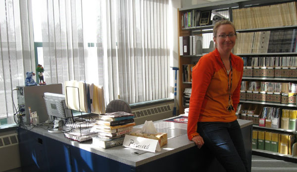 Librarian moves office to main floor of library