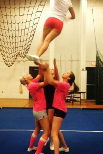 Megan Feuston and Kate Sweetman basing Emily Sajdak in a full twist with Theresa Gelinas as the back spotter