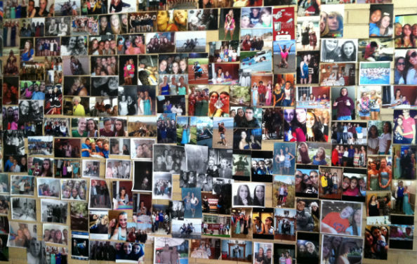 A wall of photos from a past Deck the Halls