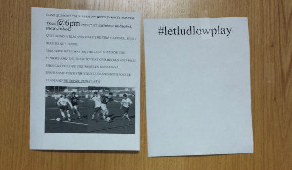 A picture of flyers around school to help get students support for the team.