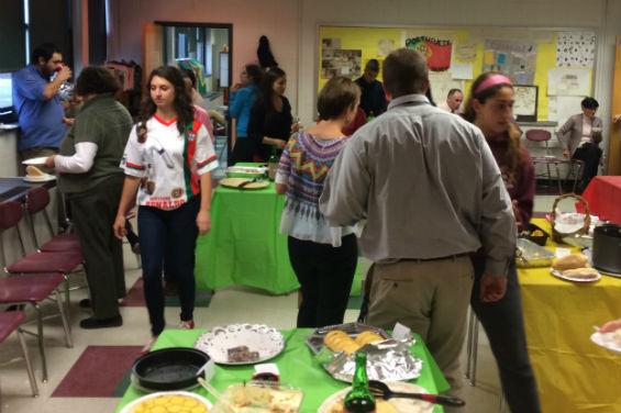 Students and teachers enjoy traditional Portuguese dishes at the event.
