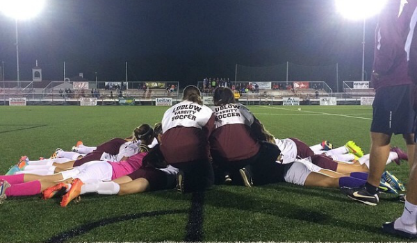 Picture take by sophomore, Taylor Masse, of the Lady Lions huddled for the last time of the season.