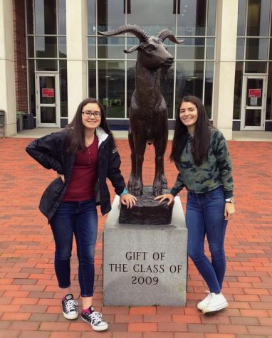 Seniors Katie Pereira and Jessica Pinto pose with the WPI goat statue after a campus tour.