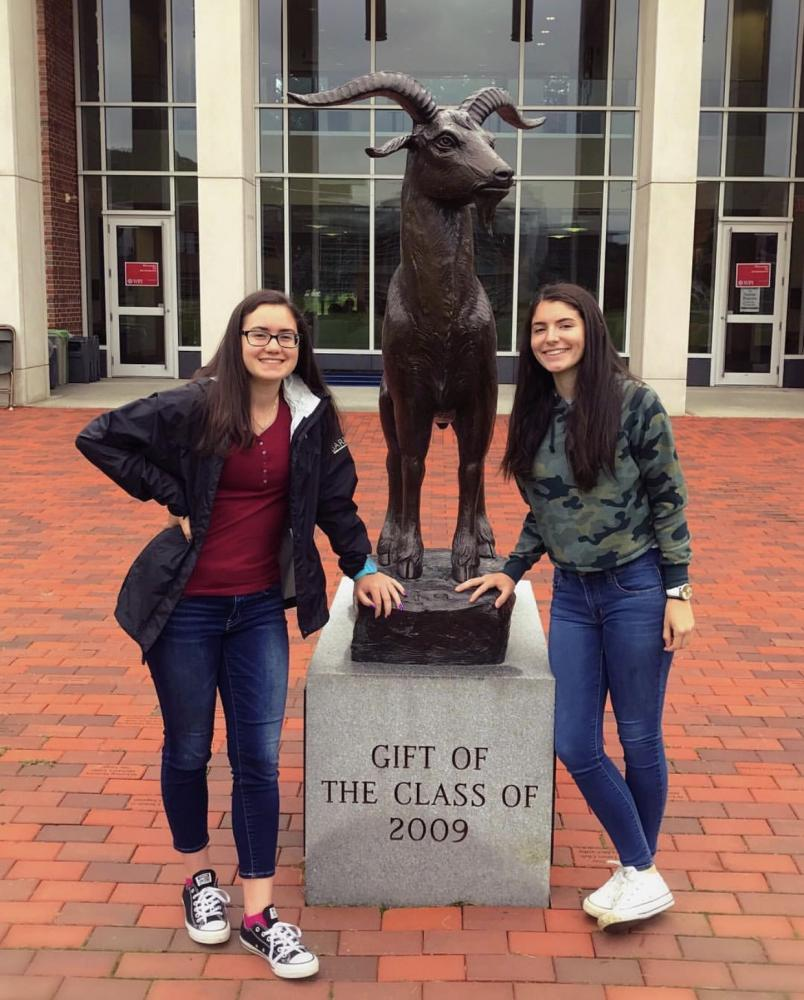 Seniors+Katie+Pereira+and+Jessica+Pinto+pose+with+the+WPI+goat+statue+after+a+campus+tour.+