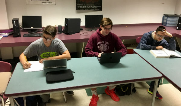 From left to right: Senior Nathan Navarro, sophomore Donald Gregory, and sophomore Sebastian Biegaj do school work in Mr. Cangemi's third period DLT.