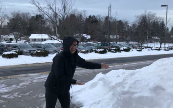 Senior Lauren Teixeira happily shows off the snow that resulted in a four-day weekend in early January.