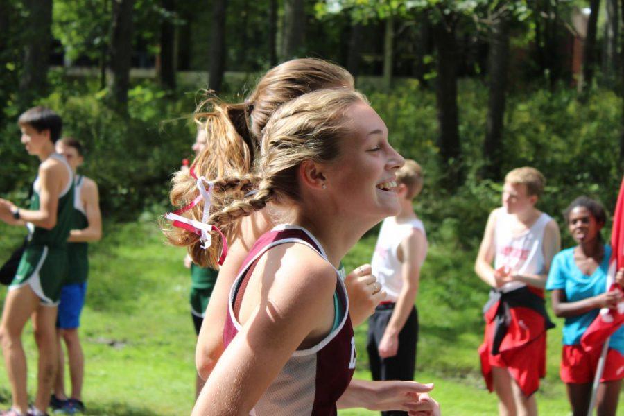Senior Bridget Murphy caught laughing during her race